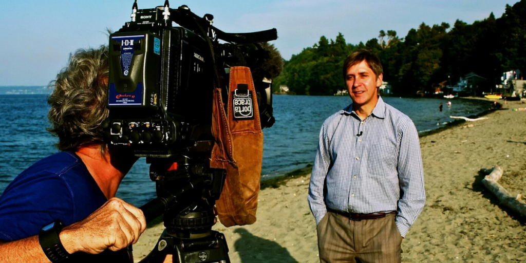 "Steve Hartman on camera with CBS News for ""On The Road"""